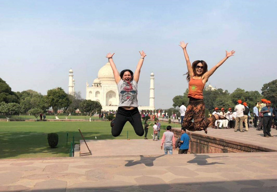 Jumping in front of the Taj Mahal